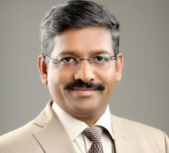 Dr. Mahesh Koregol